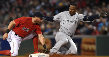 Yankees third baseman Miguel Andujar safely slides pat the tag of Red Sox second baseman Ian Kinsler on Sept. 28, 2018, at Fenway Park in Boston.