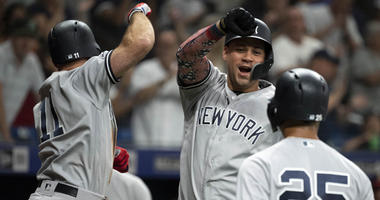 The Yankees' Brett Gardner (left) celebrates with Gary Sanchez (center) after hitting a three-run home run against the Tampa Bay Rays on July 5, 2019, at Tropicana Field in St. Petersburg, Florida.