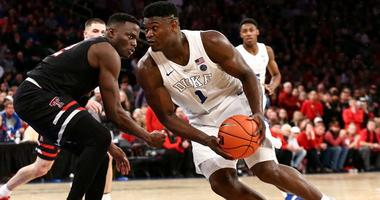 Duke Blue Devils forward Zion Williamson drives to the basket against Texas Tech Red Raiders center Norense Odiase on Dec. 20, 2018, at the Ameritas Insurance Classic at Madison Square Garden.