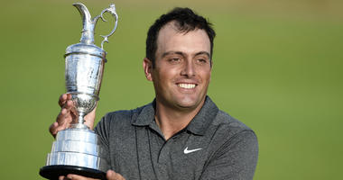 Francesco Molinari holds the Claret Jug after winning the 147th Open Championship.