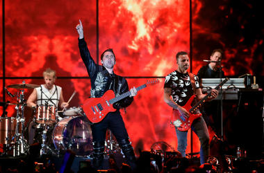 Dominic Howard, Matt Bellamy, and Chris Wolstenholme of Muse perform onstage during KROQ Almost Acoustic Christmas 2017