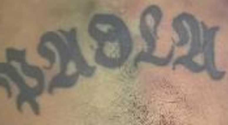 A tattoo on a man who was found dead inside of a Queens donation box.