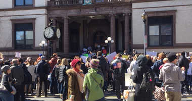 Hoboken residents hold a rally to demand stricter gun control measures.