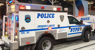 An NYPD vehicle sits on a city street.