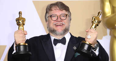 March 4, 2018; Hollywood, CA, USA; Guillermo del Toro poses with his awards for Best Picture for Best Director for The Shape of Water in the photo room during the 90th Academy Awards at Dolby Theatre.