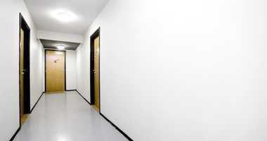 The hallway of an apartment building.