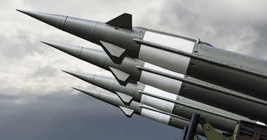 Nuclear Missles With Warhead Aimed at Stormy Sky.