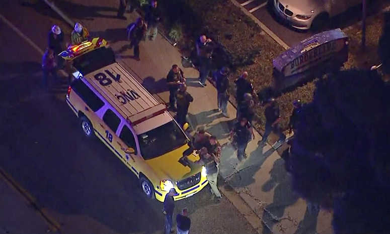 This image made from aerial video show officers around a Police SUV in the vicinity of a shooting in Thousand Oaks, California, early Thursday, Nov. 8, 2018.