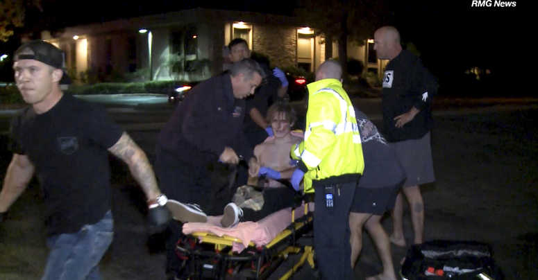 In this image taken from video a victim is treated near the scene of a shooting, Wednesday evening, Nov. 7, 2018, in Thousand Oaks, Calif.