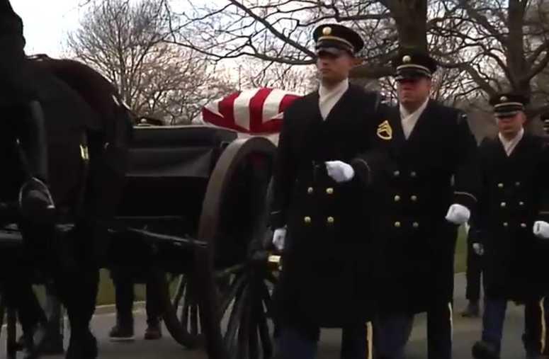 Captain Lawrence E. Dickson's casket enters the burial site in Arltington, VA.