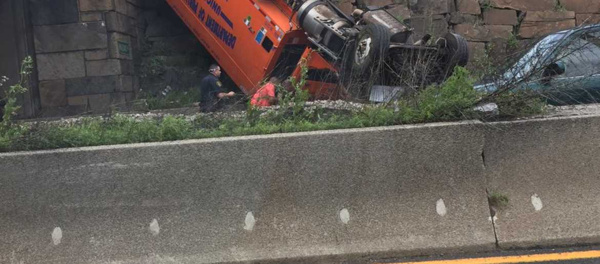 12 injured after truck overturns in NJ near Lincoln Tunnel, creating
