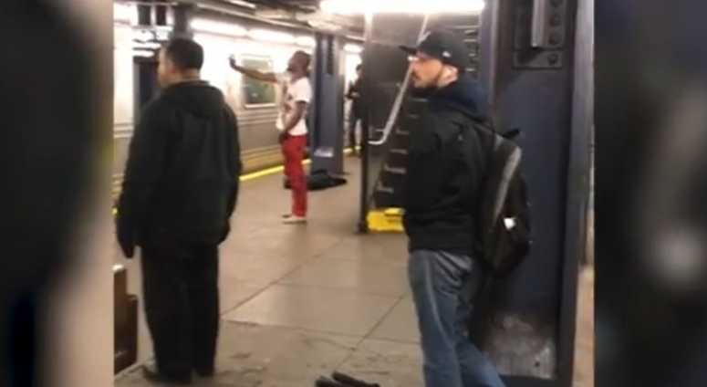A blood soaked man taunts straphangers with a knife on a Brooklyn A-train platform.
