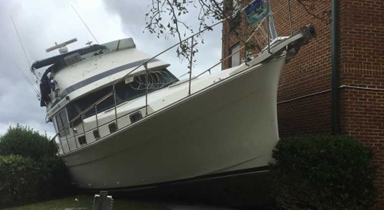 Boat pushed up to land in New Bern NC after Hurricane Florence.
