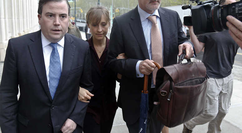 Actress Allison Mack, center, arrives with her legal team to Brooklyn Federal Court, Friday May 4, 2018, in New York.