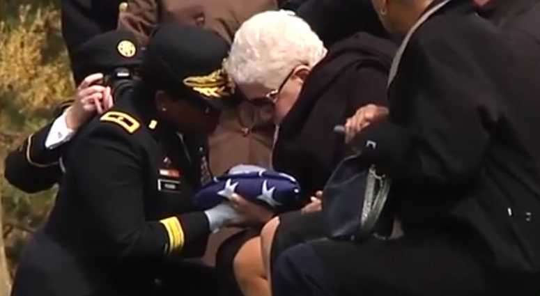 Marla Andrews presented the flag from her father's casket, Captain Lawrence Dickson.