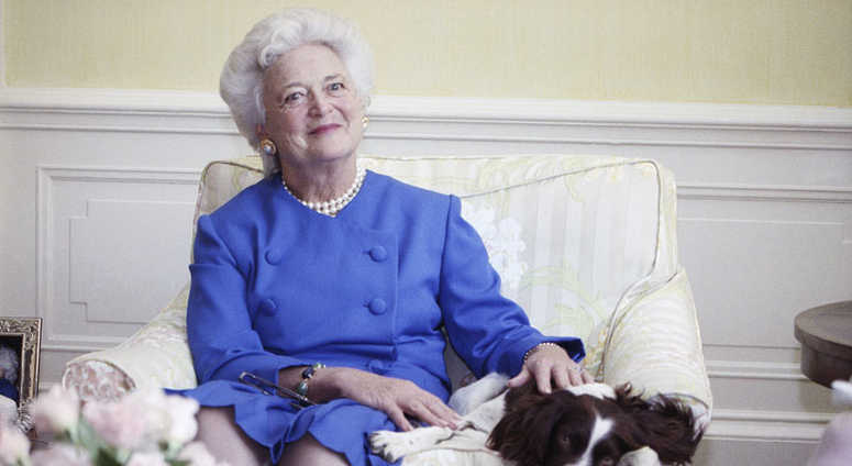 In this 1990 file photo, first lady Barbara Bush poses with her dog Millie in Washington. A family spokesman said Tuesday, April 17, 2018, that former first lady Barbara Bush has died at the age of 92.