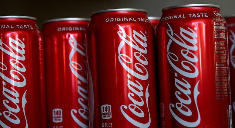 SAN RAFAEL, CA - JULY 25: Cans of Coca Cola are displayed on July 25, 2018 in San Rafael, California.