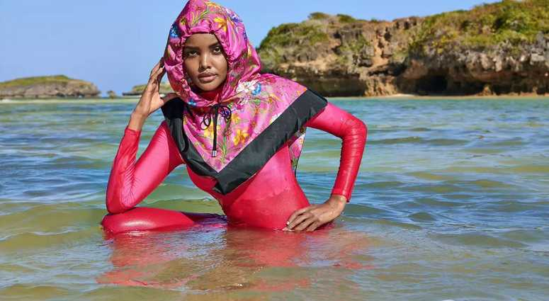 4eaeb0847d60f SI Swimsuit issue features Halima Aden wearing a hijab, burkini - a first  for the mag