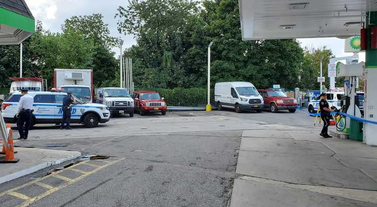 Woman killed at Queens gas station