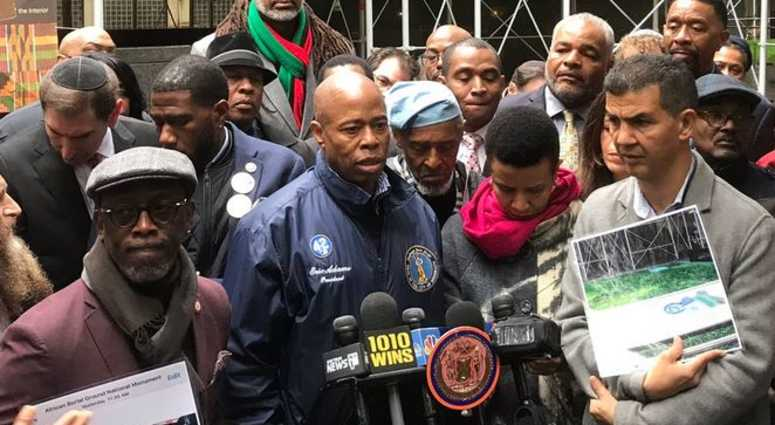 Brooklyn Borough President Eric Adams is offering a reward in a case of racist vandalism at the African Burial Ground.