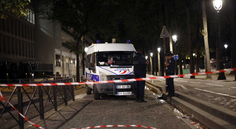 An evidence is seen at the site of a knife attack in Paris, Monday, Sept. 10, 2018. A several people were injured in a knife attack in central Paris late Sunday but police said that terrorism was not suspected.