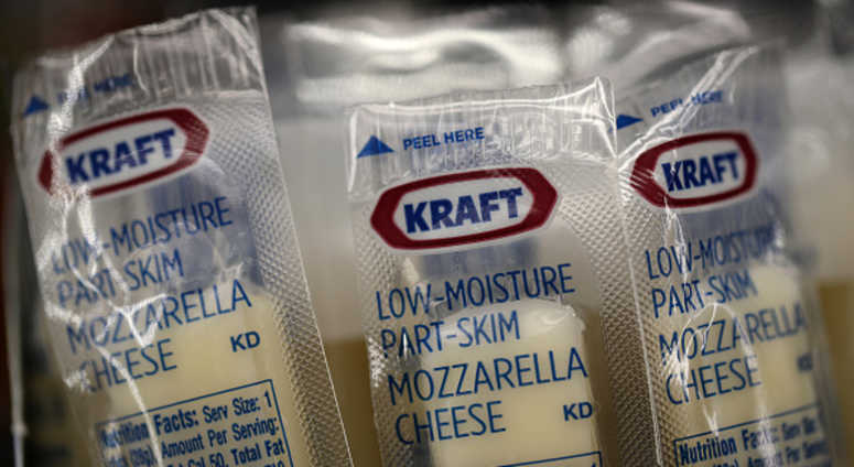 Packages of Kraft mozzarella cheese are displayed on a grocery store shelf on February 22, 2019