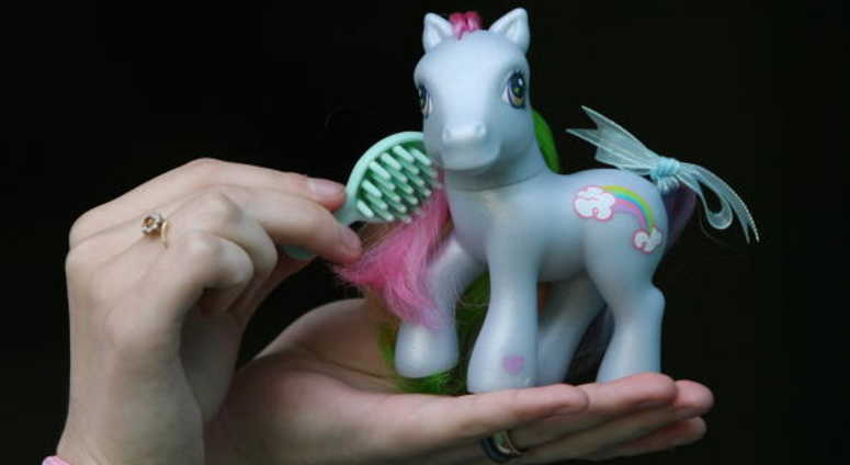 A collector prepares her My Little Pony for display at the My Little Pony Convention
