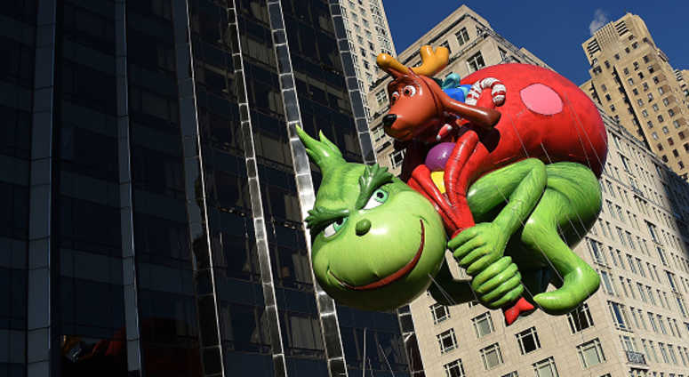 The Dr. Seuss Grinch and Max balloon floats down Central Park West and into Columbus Circle during the 91st Annual Macy's Thanksgiving Day Parade on November 22, 2017 in New York City.