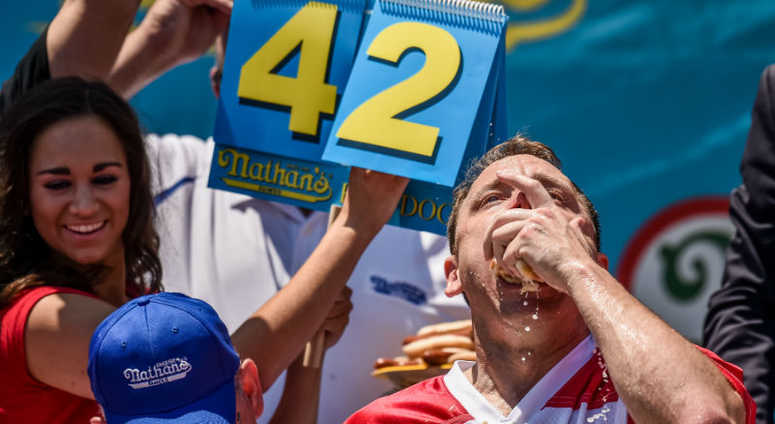 "Joey ""Jaws"" Chestnut competes in Nathan's Famous 101th Anniversary of the 4th of July hot dog-eating contest at Coney Island."