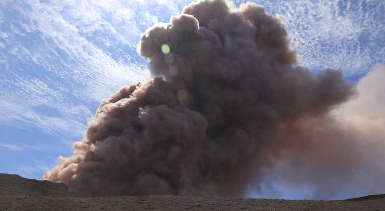 In this photo released by U.S. Geological Survey, a plume of ash rises from the Puu Oo vent on Hawaii's Kilaueaa Volcano after a magnitude 5.0 earthquake, Thursday, May 3, 2018 in Hawaii Volcanoes National Park. Hawaii's Kilauea volcano erupted Thursday.