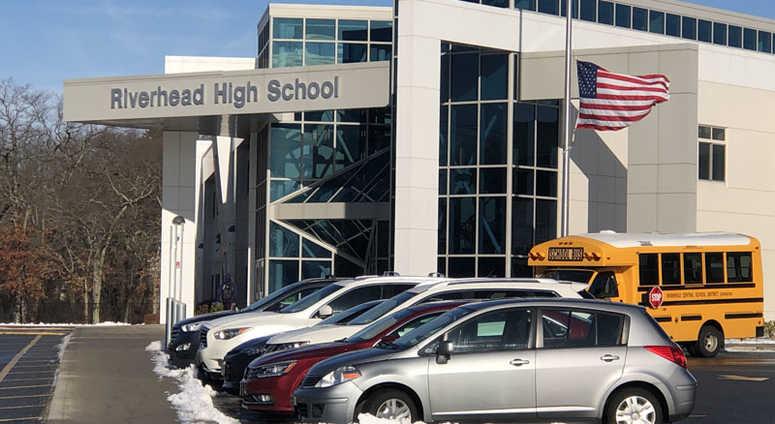 Flag at half staff outside Riverhead High School
