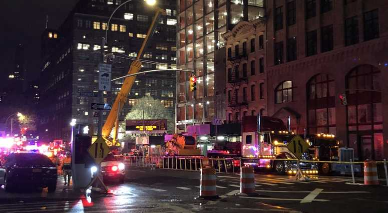 NYPD and EMS on the scene in response to a construction accident.