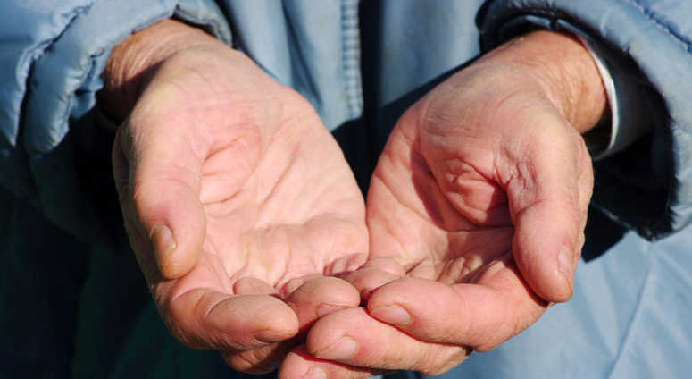 Hands of a beggar with coins