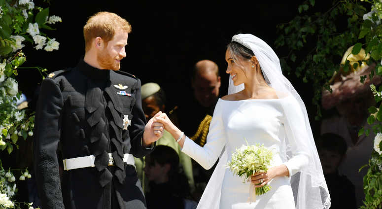 5/19/2018 - Prince Harry and Meghan Markle leave St George's Chapel in Windsor Castle after their wedding.