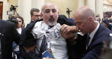 Security staff push out a man after a scuffle prior to a press conference after the meeting of U.S. President Donald Trump and Russian President Vladimir Putin at the Presidential Palace in Helsinki, Finland, Monday, July 16, 2018.