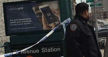 Police on the scene in Queens where a gunshot victim dragged himself off an F train.