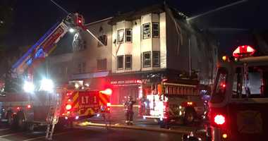 A woman was killed when a fire ripped through two buildings in Bayonne.