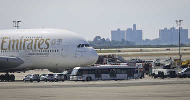 Emergency response crews gather outside a plane at New York's Kennedy Airport amid reports of ill passengers aboard a flight from Dubai, Wednesday, Sept. 5, 2018
