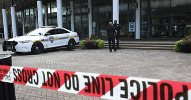 Jacksonville police officers guard an area Monday, Aug. 27, 2018, near the scene of a fatal shooting at The Jacksonville Landing