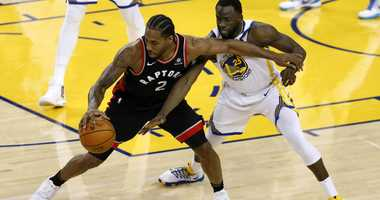 Kawhi Leonard of the Toronto Raptors is defended by Draymond Green of the Golden State Warriors during Game 3 of the 2019 NBA Finals.