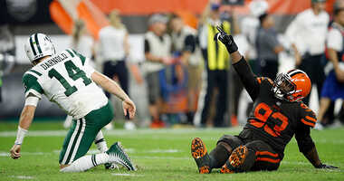 Trevon Coley #93 of the Cleveland Browns celebrates in front of Sam Darnold #14 of the New York Jets