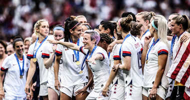 Megan Rapinoe of the USA celebrates with team mates following her team's victory in the 2019 FIFA Women's World Cup France Final match between The United States of America and The Netherlands