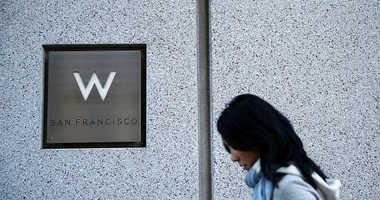 A pedestrian walks by a W hotel
