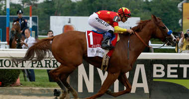 ELMONT, NY - JUNE 09: Justify #1, ridden by jockey Mike Smith crosses the finish line to win the 150th running of the Belmont Stakes at Belmont Park on June 9, 2018 in Elmont, New York. Justify becomes the thirteenth Triple Crown winner.