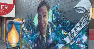 A mural dedicated to Lesandro Guzman Feliz outside the bodega where he was stabbed to death in the Bronx.