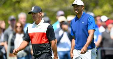 Brooks Koepka and Tiger Woods walk the course at Bethpage Black during the first round of the 2019 PGA Championship.