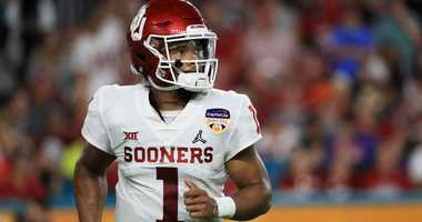 Oklahoma quarterback Kyler Murray jogs onto the field during the College Football Playoff semifinal against Alabama.