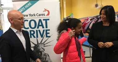 New York Cares hands out coats at the Island School on E. Houston Street.