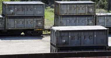 """This April 12, 2018 photo shows containers that were loaded with tons of sewage sludge in Parrish, Ala. More than two months after the so-called """"Poop Train"""" rolled in from New York City,"""