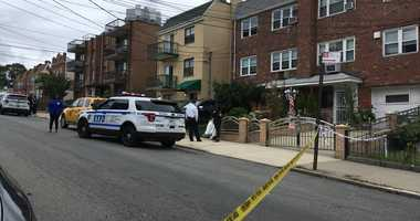 The scene of what is believed to be a murder-suicide in which an off-duty Yonkers cop was also wounded in Queens.